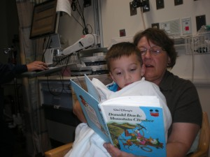 My little treasure prepares for his MRI, blissfully distracted by his Grandma.