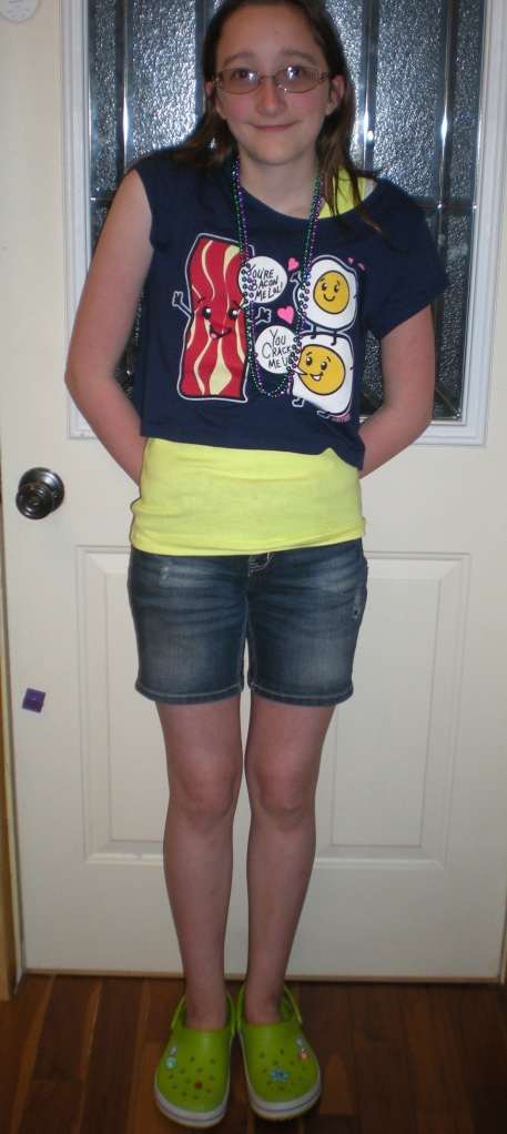 My daughter in one of her new looks. Justice denim shorts, Justice Yellow tank, and Justice egg and bacon t-shirt. (Don't forget her new bright green crocs with ice cream jibbits!) :)